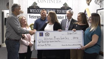 Greater Erie Area Board of Realtors presents check to VMCE
